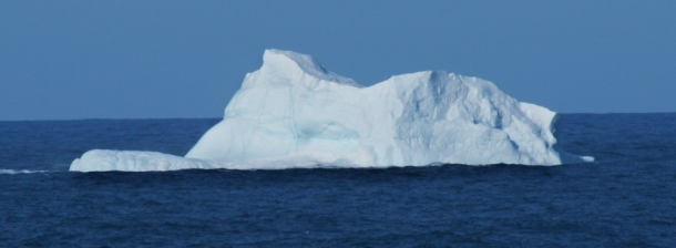 An iceberg drifting along in spring.