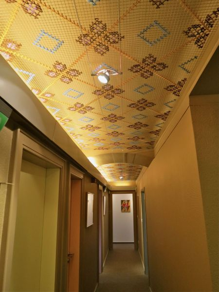 Cross stitch installation for  a faux ceiling
