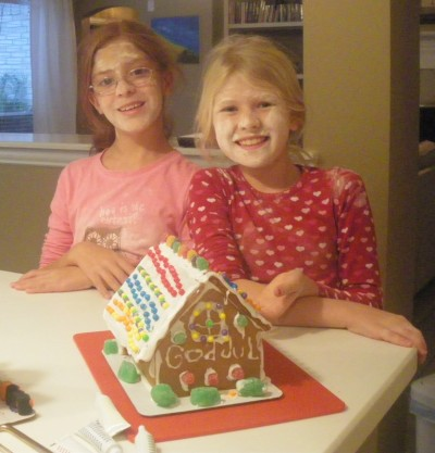 Two good friends making ginger bread houses for Christmas in Texas/Katy